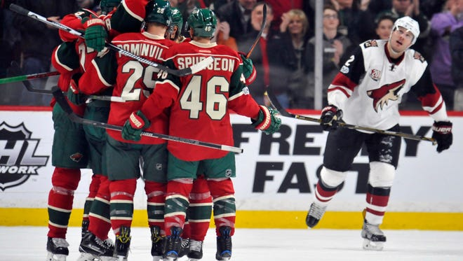 Minnesota Wild celebrate a goal scored by forward Nino Niederreiter (22) during the first period against the Arizona Coyotes at Xcel Energy Center, Jan. 19, 2017.