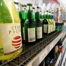 Bottles of Polish cider sit on a shelf in a small store in Warsaw, Poland. A Russian ban on European food imports has sparked a debate in Poland over whether to allow advertising cider. The country is a major global apple exporter and had previously sent half its output to Russia.