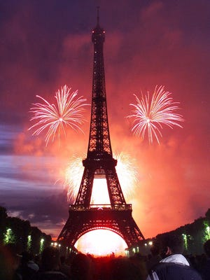 Fireworks light the Eiffel Tower in Paris on July 14, 2001, as part of the Bastille Day celebrations.