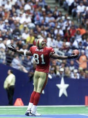 Sept. 24, 2000: 49ers receiver Terrell Owens celebrates a touchdown against the Cowboys by standing on the star logo in the middle of the field.