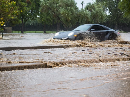 The Indian Bend Wash goes over the bank forcing the closure of Hayden Road in Scottsdale in 2014.