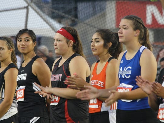 Robert Lee's Margo Mendoza, second from right, and (far right) Rocksprings' Zoe Burleson, competing last year for Nueces Canyon, are introduced at the UIL State Track and Field Championships in 2017. Both return to the competition in 2018.