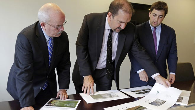 Security adviser Terrance Gainer, left, reviews security plans for a proposed medical marijuana facility with Kenneth Bouch, center, and Ben Kovler, right, of Green Thumb Industries, Aug. 13, 2014.