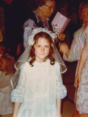 Michele Johnson at age 8, doing First communion, at