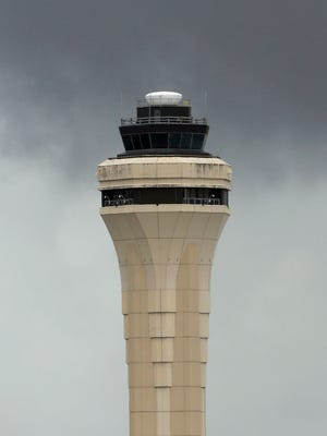 This file photo from April 22, 2013, shows the air traffic control tower at Miami International Airport.