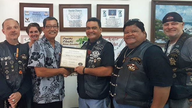 The Harley Owners Group, Marianas Islands Chapter officers stopped by the office of Sen. Joe S. San Agustin in Tamuning on Aug. 8 to thank him for serving as a gold sponsor for the group's Ninth Annual Charity Golf Tournament, held June 17 at Onward Talofofo Golf Club. The event raised funds for the Salvation Army Lighthouse Recovery Center and the Alee Shelter for Women & Children. Pictured, from left: Mike Setzer, membership officer; Kelly Rodriguez, Ladies of Harley; San Agustin; Ray Quintanilla, director; John Sablan, member; and Patrick Taylor, safety officer.