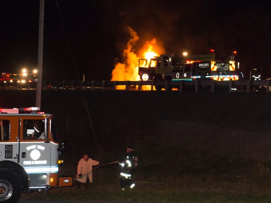 First responders work to put out a fire from a fuel tanker on Interstate 81 near mile marker 18.5 near the Chambersburg Mall Thursday, Nov. 24, 2016.