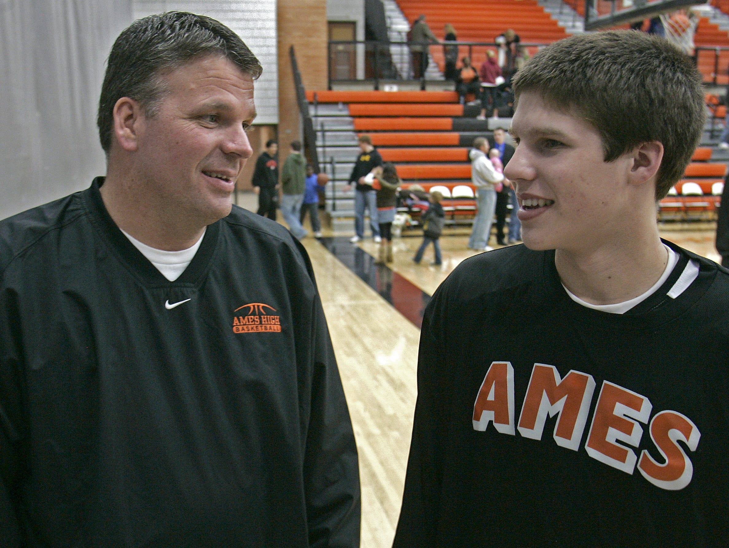 Former Iowa State head men's basketball coach Greg McDermott, left, talked with his son, former Ames High School basketball player Doug McDermott, after Doug scored 18 points in a win over Ft. Dodge on Feb. 12, 2009.