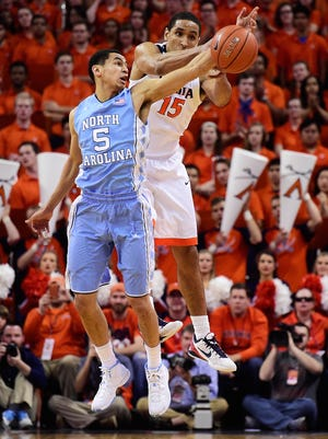 Marcus Paige of the North Carolina Tar Heels steals the ball from Malcolm Brogdon of the Virginia Cavaliers in the first half during their game at John Paul Jones Arena.