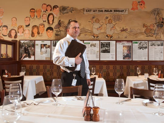 Paul Sandler, general manager of the Palm Restaurant in Atlantic City, stands in a dining area of the Palm. 01.15.14