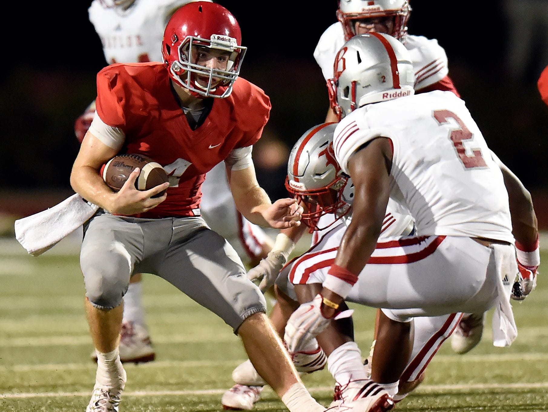 Brentwood Academy quarterback Jeremiah Oatsvall (4) runs the ball before being tackled by Baylor cornerback Brendon Harris (2) during second half of an high school football game on Friday, Sept. 16, 2016, in Brentwood, Tenn. Brentwood Academy won 35-0.
