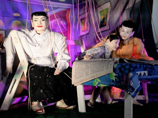 Burmese marionette puppets teach lessons to children