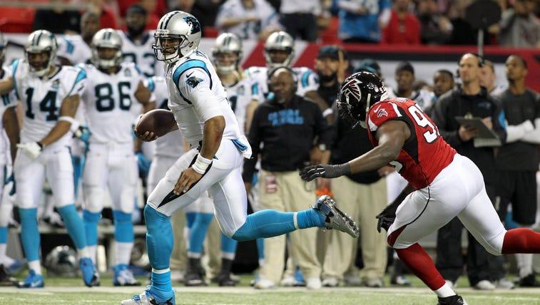 Carolina Panthers quarterback Cam Newton (1) runs the