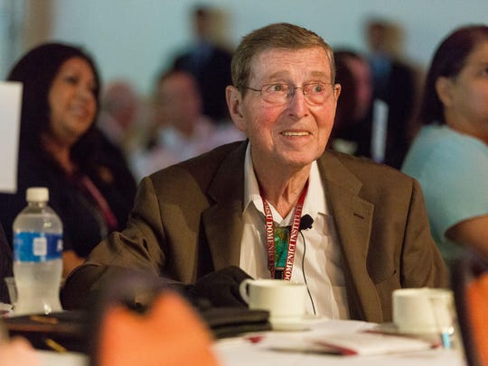 Former Sen. Pete Domenici attends his signature Domenici
