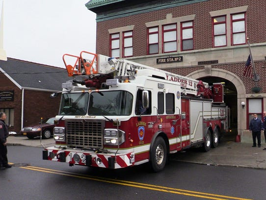 New Rochelle Fire Department Ladder 12 pulls out of