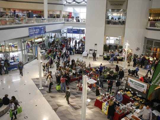 Hundreds of shoppers walk from vendor to vendor during