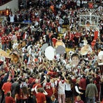 Indiana fans rush the court after knocking off third-ranked Wisconsin on Tuesday at Assembly Hall.