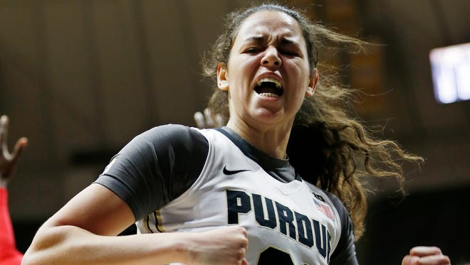 Dominique McBryde reacts after scoring a drawing a foul against Rutgers in the overtime period Thursday, February 25, 2016, at  Mackey Arena. McBryde's score put Purdue up 69-66. She hit her free throw to give the Boilermakers a four point cushion at 70-66. Purdue defeated Rutgers 74-68 OT.