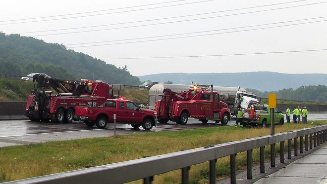 A tanker truck stretches across the westbound lane of I-86 near Corning on Monday.