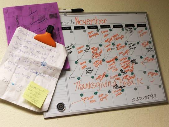 A calendar in La'Kirra Tillman's kitchen shows her