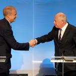 Republican Bruce Rauner, left, and Illinois Gov. Pat Quinn shake hands at their debate. (Charles Rex Arbogast, AP)