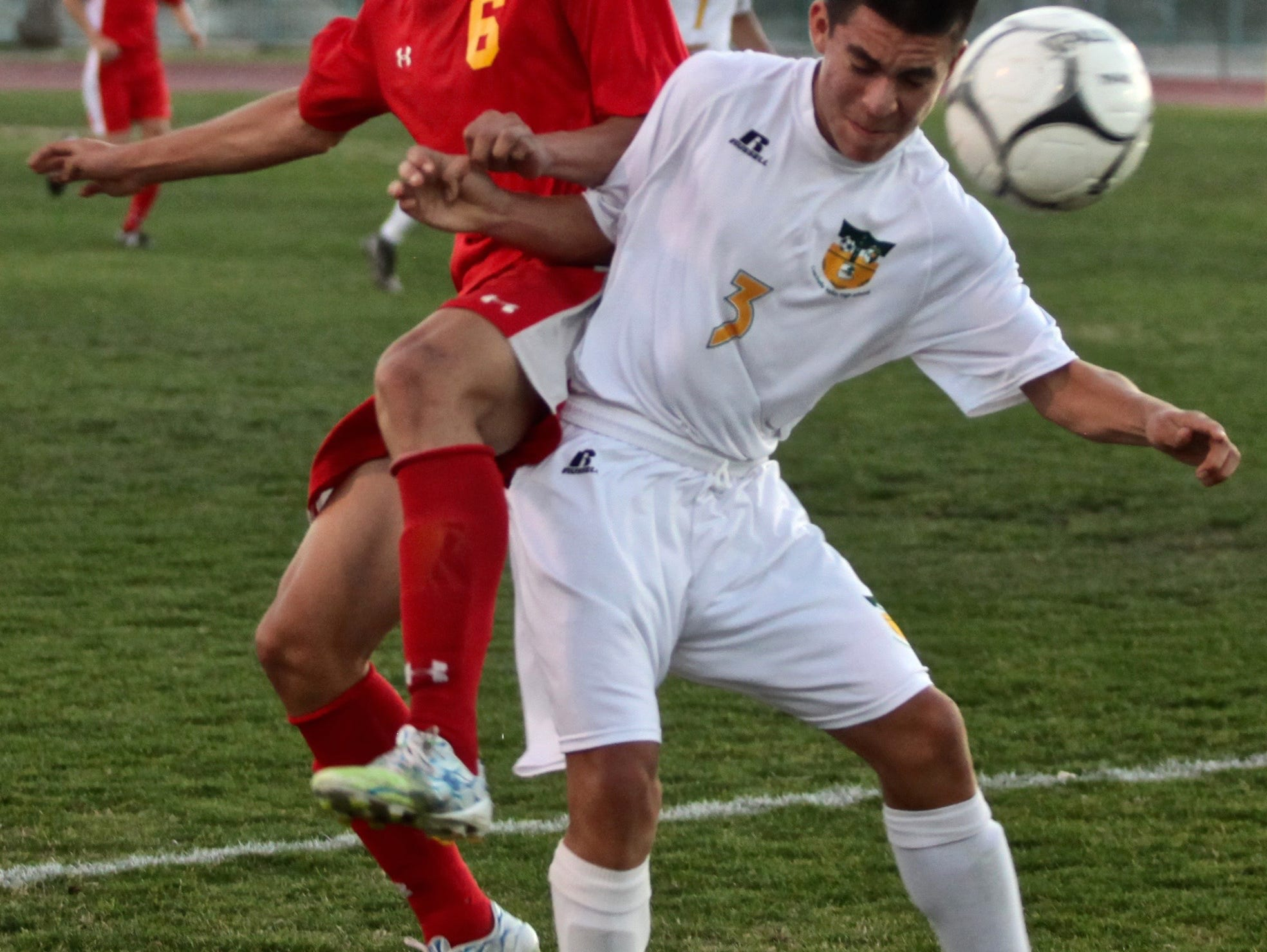 Palm Desert's Gerardo Serrano (6) and Coachella Valley's Oscar Cervantes (3) battle for the ball during a match in Thermal on Tuesday.