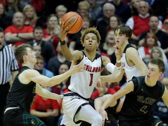 New Albany's Romeo Langford gets his own rebound against Floyd Central defenders in the Indiana 4A Sectional final. March 3, 2018