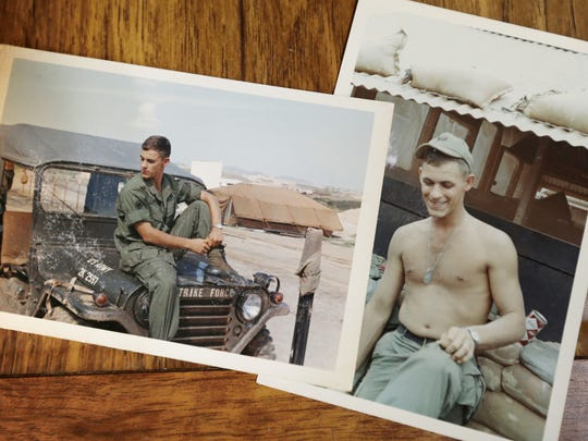 Vietnam veteran John Vandehaar of Des Moines sorts through photographs of him and the base camp where he served during the Vietnam War, on May 15.