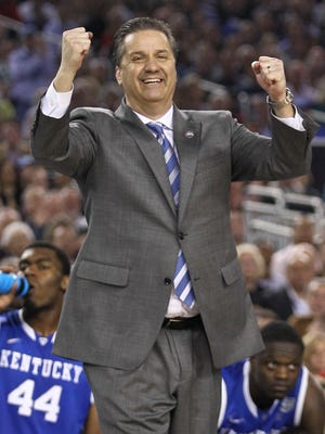 Kentucky head coach John Calipari had a big smile for Alex Poythress in the second half at the Final Four at AT&T Stadium in Arlington, Texas. Kentucky beat Wisconsin 74-73 to advance to the national championship game against UConn. April 5, 2014