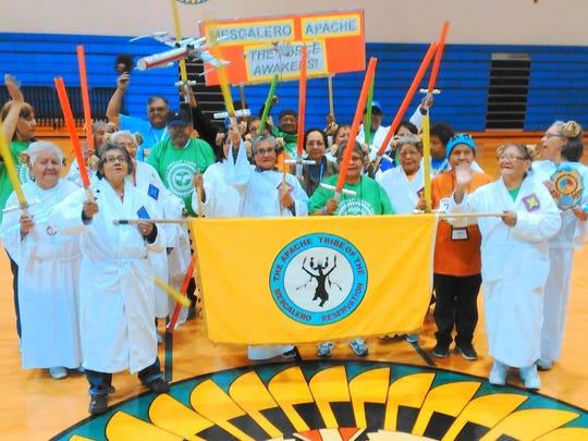 Members of the Mescalero Apache Senior Olympics team celebrate