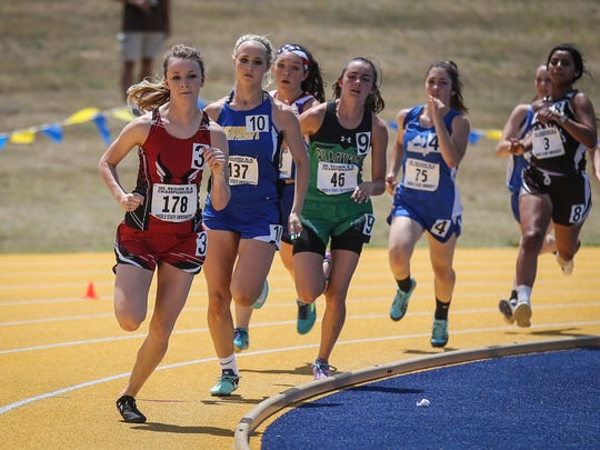 Garden City's Kenzie Schaefer leads the pack in the 800 meter run during the Region II-1A Track Meet Saturday, April 28, 2018, at Angelo State.