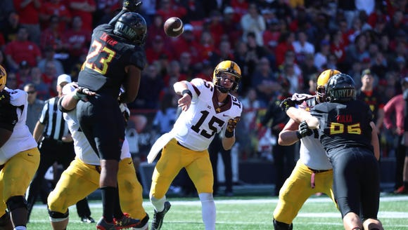 Minnesota Golden Gophers quarterback Conor Rhoda (15)