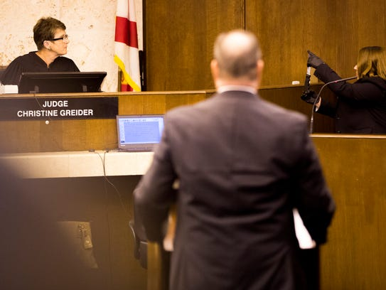 Collier County Sheriff's Office investigator Jessica Gerster, during a hearing Monday, Oct. 23, 2017, presents the knife that authorities said Mesac Damas used to kill his wife and five children. Collier Circuit Judge Christine Greider presided over the Spencer hearing at the Collier County Government Center in East Naples.