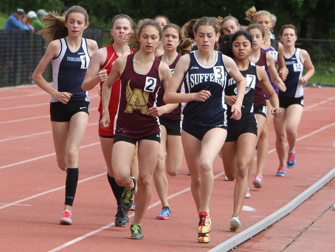 A pack of runners compete at the Section 1 Class AA Track and Field Championships at Suffern on Saturday.