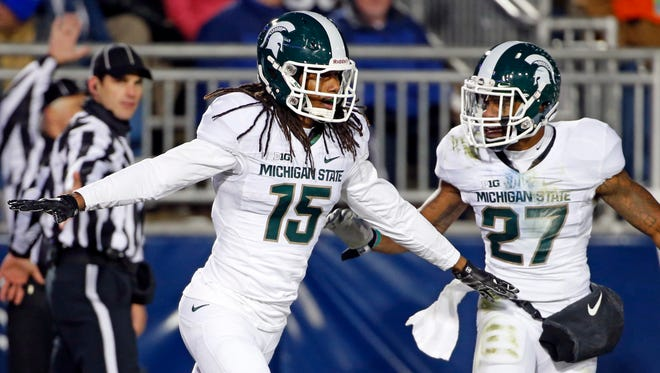 Michigan State cornerback Trae Waynes (15) and safety Kurtis Drummond celebrate an interception against Penn State on Nov. 29, 2014.
