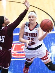 USI's Morgan Dahlstrom shoots a contested layup over Bellarmine's Beth Bower on January 16, 2016.