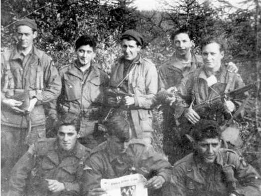 PFC Joseph Favela is in the front row, on the right. Photo was taken during the fighting following the airborne drop into Holland in September 1944.