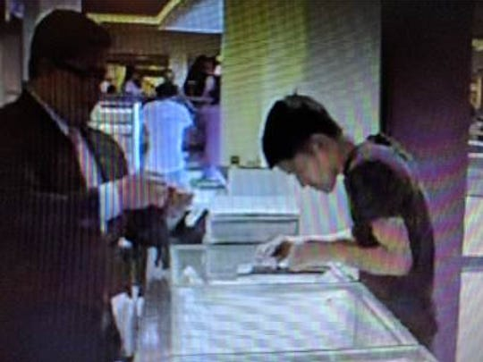 Security camera image of a young man who asked to a see a Gucci watch inside a display case at Helzberg Diamonds in Cielo Vista Mall.