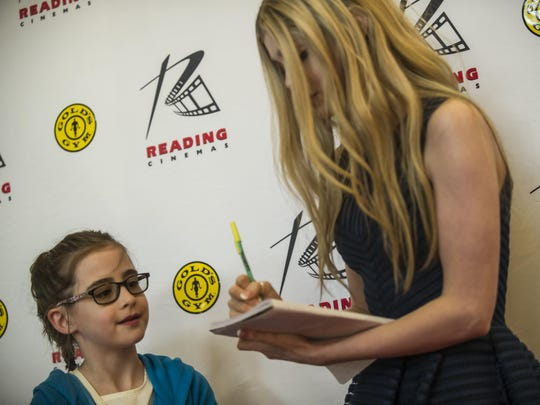 "Elena Kampouris, a Bridgewater-raised actress who stars in ""My Big, Fat Greek Wedding 2,"" signs an autograph for Nicole Moscatelli, 10, of Bridgewater, at the Reading Cinemas in Manville on March 25, 2016."