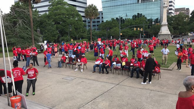 About 200 teachers and state employees rallied at the Statehouse on Saturday to call for better pay and conditions.