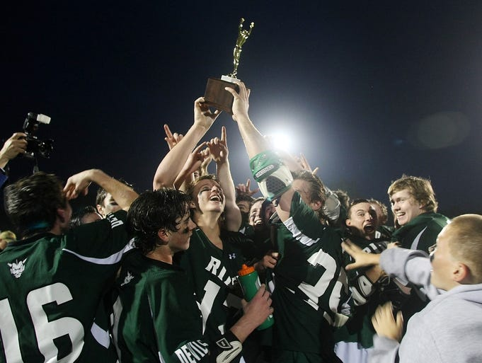 Ridge celebrates their 8-6 victory over Immaculata in the Somerset County Lacrosse Tournament final, Thursday, May 15, 2014, at Ridge High School in Bernards Twp, NJ.  Photo by Jason Towlen