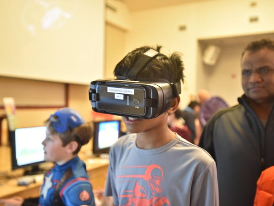 Hrutvik Pamuluri, 12, checks out the VR equipment at
