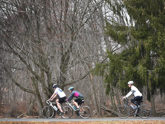Bikers ride around the pond at the Saddle River County