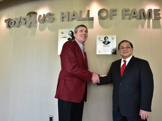 Victor Fung being inducted as second honoree in the Toys R US hall of fame at the Wayne headquarters, by CEO David Brandon (left). Toys R Us founder Charles Lazarus was the first inductee. Photo: Marko Georgiev/Staff