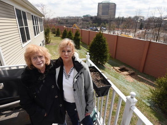 Residents Sheila Kovar(L) and Denise Stone(R) stand