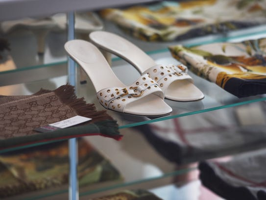 The store will sell pre-owned designer handbags, shoes, jewelry, accessories, and will also accept items to sell on consignment.