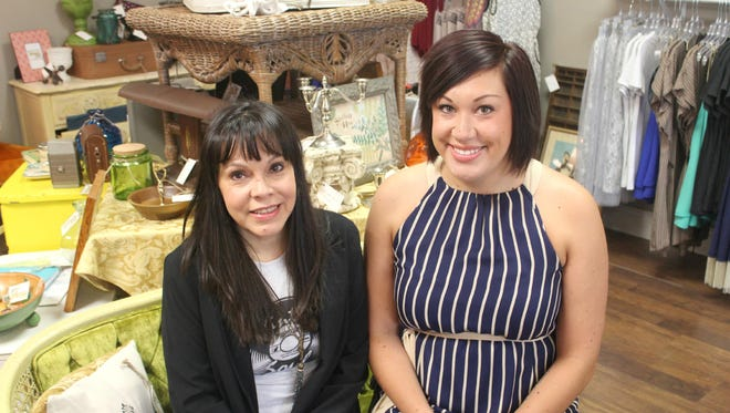 Mother Yolanda Halferty, left, and daughter Dakota Zirbel opened their North Liberty-based boutique, Vintage Soul, in May 2015.