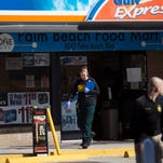 Members of the Lee County Sheriff's Office work the scene of a homicide at the Gulf Express on Palm Beach Boulevard.  The clerk was killed.