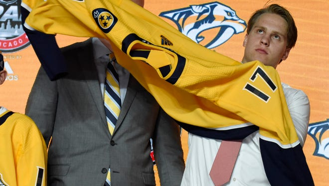 Eeli Tolvanen poses for photos after being selected at No. 30 by the Predators.