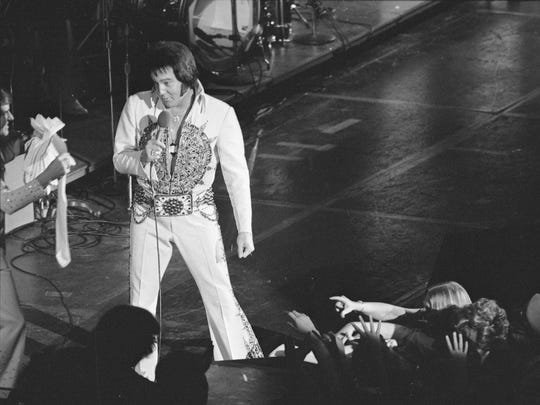 Elvis Presley performs at the Milwaukee Arena on April 27, 1977, less than four months before his death.